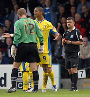 Photo: Ashley Pickering.<br /> Gillingham v Leeds United. Coca Cola League 1. 29/09/2007.<br /> Ref Danny McDermid (R) watches as Jermaine Beckford of Leeds (no. 9) leaves the pitch after being sent off