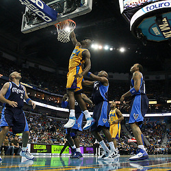 January 21, 2012; New Orleans, LA, USA; New Orleans Hornets center Emeka Okafor (50) dunks against the Dallas Mavericks during the first half of a game at the New Orleans Arena.   Mandatory Credit: Derick E. Hingle-US PRESSWIRE