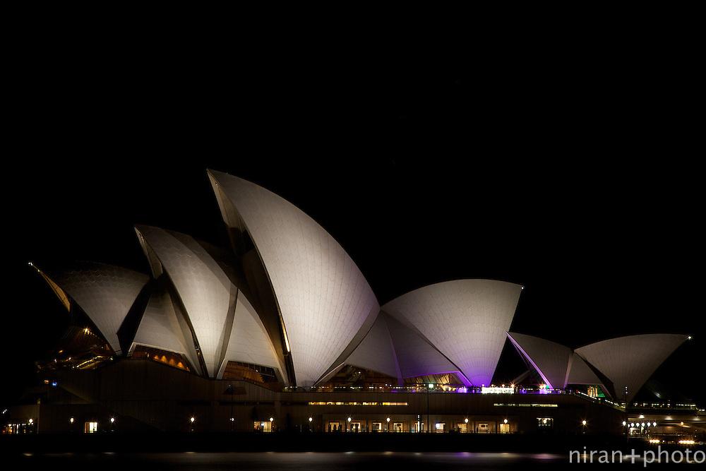 A night-shot of the iconic Sydney Opera House.