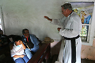 Jay Johnson Castro is blessed with water from the Rio Grande by Father Roy Snipes at La Lomita Mission, a historical landmark in Mission, Texas.