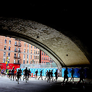 Runners make their way under the Queensboro Bridge along First Avenue in Manhattan, New York, during the ING New York Marathon. New York, USA. 3rd November 2013. Photo Tim Clayton