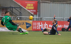 Alloa Athletic's keeper Neil Parry  and Falkirk's Zak Rubben. Falkirk 1 v 2 Alloa Athletic, Scottish Championship game played 6/4/2019 at The Falkirk Stadium.