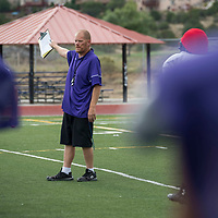 Patriots Head Coach John Roanhaus runs the drills with the kickoff and return teams before their team faces off against  the Aztec Tigers at home on Friday at Miyamura High School in Gallup, NM.