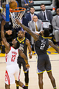 Houston Rockets guard James Harden (13) lays the ball into the basket against Golden State Warriors center Jordan Bell (2) during Game 4 of the Western Conference Finals at Oracle Arena in Oakland, Calif., on May 22, 2018. (Stan Olszewski/Special to S.F. Examiner)