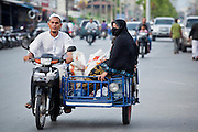 """Sept. 24, 2009 -- PATTANI, THAILAND:  Muslim families on motorized trishaws in Pattani, Thailand. Thailand's three southern most provinces; Yala, Pattani and Narathiwat are often called """"restive"""" and a decades long Muslim insurgency has gained traction recently. Nearly 4,000 people have been killed since 2004. The three southern provinces are under emergency control and there are more than 60,000 Thai military, police and paramilitary militia forces trying to keep the peace battling insurgents who favor car bombs and assassination.   Photo by Jack Kurtz"""