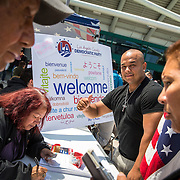 Ivan Vazquez, 32, registers as a Democrat following the swearing-in ceremony for new citizens at the LA Convention Center.
