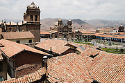 Rooftop view of the Cathedral de Santo Domingo (left), the Iglesia del Trunfo and the Plaza de Armas in Cusco, Peru.