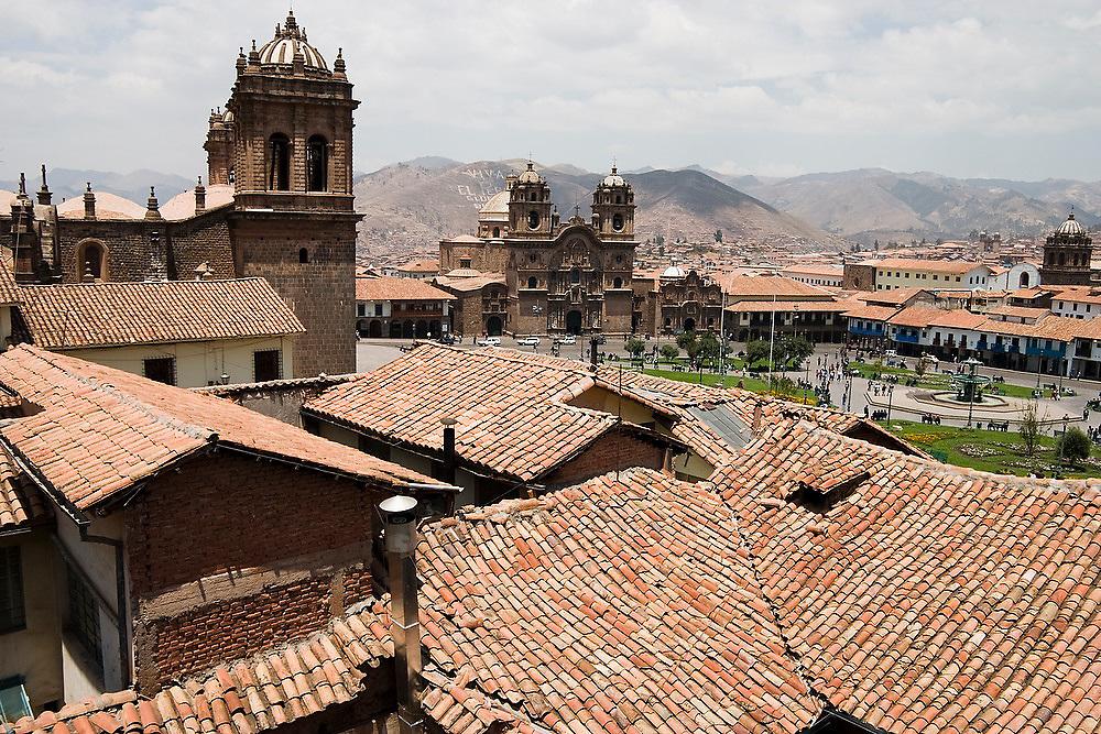Rooftop view of the Cathedral de Santo Domingo (left), the Iglesia del Trunfo and the Plaza de Armas in Cusco, Peru.