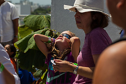 Isla Higginbotham watches the solar eclipse at the Phillip and Patricia Frost Museum of Science on Monday, Aug. 21, 2017. Photo by Sebastian Ballestas/Miami Herald/TNS/ABACAPRESS.COM