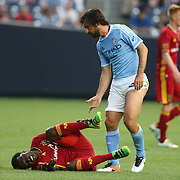 NEW YORK, NEW YORK - June 02: Andrea Pirlo #21 of New York City FC was booked for a foul on Stephen Sunny Sunday #8 of Real Salt Lake during the NYCFC Vs Real Salt Lake regular season MLS game at Yankee Stadium on June 02, 2016 in New York City. (Photo by Tim Clayton/Corbis via Getty Images)