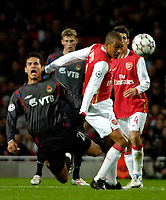 Photo: Ed Godden.<br /> Arsenal v CSKA Moscow. UEFA Champions League, Group G. 01/11/2006. Arsenal's Gilberto (R) fouls Dudu.