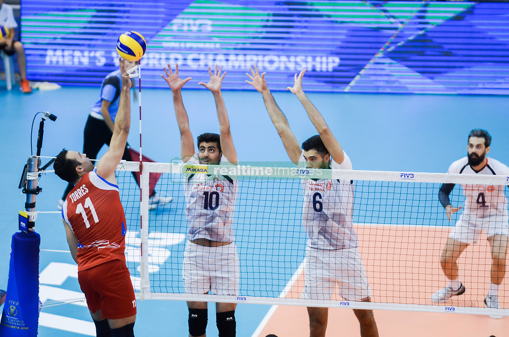 September 12, 2018 - Varna, Bulgaria - Maurice Torres, L, Puerto Rico play the ball against Amir Ghafour and Mohammad Mousavi Eraghi Seyed, Iran, during Iran vs Puerto Rico, pool D, during 2018 FIVB Volleyball Men's World Championship Italy-Bulgaria 2018, Varna, Bulgaria on September 12, 2018  (Credit Image: © Hristo Rusev/NurPhoto/ZUMA Press)