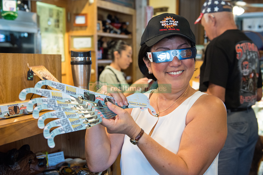 Carol Jensen, a produce purveyor for Black Bear Diner, is seen displaying solar glasses for sale at Black Bear Diner in Madras, Oregon on Saturday, Aug. 19, 2017. She is volunteering her time to help prepare for the crowds arriving to watch the total solar eclipse. The eclipse will be sweeping across a narrow portion of the contiguous United States from Lincoln Beach, Oregon to Charleston, South Carolina on August 21, 2017. A partial solar eclipse ill be visible across the entire North American continent along with parts of South America, Africa, and Europe.  Photo Credit: (NASA/Aubrey Gemignani)