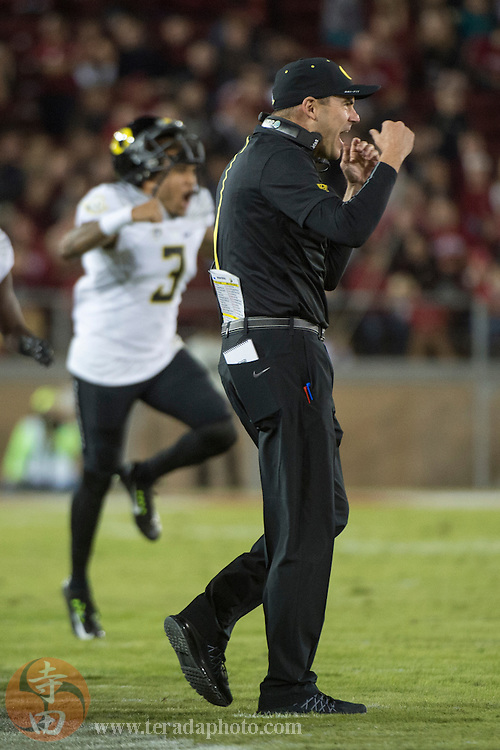 November 14, 2015; Stanford, CA, USA; Oregon Ducks head coach Mark Helfrich (right) and quarterback Vernon Adams Jr. (3) celebrate during the third quarter against the Stanford Cardinal at Stanford Stadium. The Ducks defeated the Cardinal 38-36.