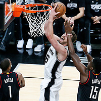 03 May 2017: San Antonio Spurs center Pau Gasol (16) goes for the layup past Houston Rockets center Clint Capela (15) and Houston Rockets forward Trevor Ariza (1) during the San Antonio Spurs 121-96 victory over the Houston Rockets, in game 2 of the Western Conference Semi Finals, at the AT&T Center, San Antonio, Texas, USA.