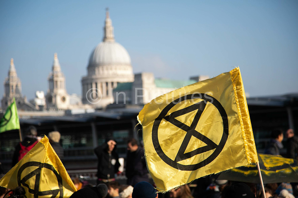 Thousands of Extinction Rebellion activists took over 5 bridges in Central London and blocked them for the day, November 17 2018, Central London, United Kingdom. Blackfriars Bridge; a peacefull occupation of the bridge begins. Around 11am people on all bridges sat down in the road and blocked traffic from coming through and stayed till late afternoon. The actvists believe that the government is not doing enough to avoid catastrophic climate change and they demand the government take radical action to save future generations and the planet. Many are willing to be arrested peacefully protesting and up to 80 were arrested on the day.Extinction Rebellion is a grass root climate change group started in 2018 and has gained a huge following of people commited to peaceful protests and who ready to be arrested. Their major concern is that the world is facing catastropohic climate change and they want the British government to act now to save future generations.