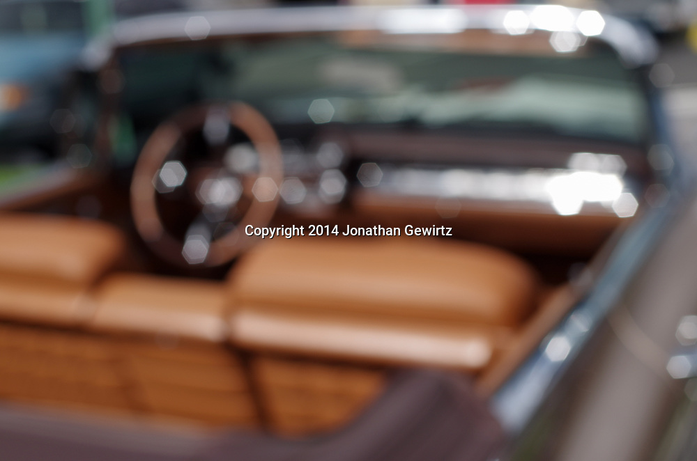 A blurred, dreamy view of the passenger compartment of a 1960 Cadillac convertible. WATERMARKS WILL NOT APPEAR ON PRINTS OR LICENSED IMAGES.
