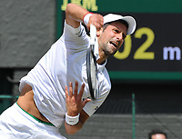 Tennis - 2019 Wimbledon Championships - Week Two, Friday (Day Eleven)<br /> <br /> Men's Singles, Semi-Final: Novak Djokovic (SRB) vs. Roberto Bautista Agut (ESP)<br /> <br /> Djokovic serves, on Centre Court.<br /> <br /> COLORSPORT/ANDREW COWIE