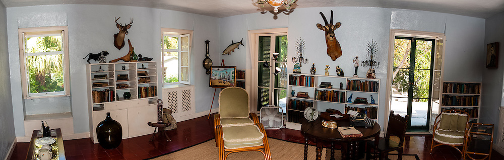 US, Florida, Key West. Interior, Ernest Hemingway Home. The Library, stitched panorama.