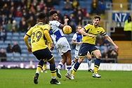 Oxford United Defender, John Mousinho (30) beats Bristol Rovers Forward, Ellis Harrison (9) to the ball during the EFL Sky Bet League 1 match between Oxford United and Bristol Rovers at the Kassam Stadium, Oxford, England on 10 February 2018. Picture by Adam Rivers.