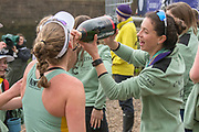 Greater London. United Kingdom, Cambridge Women's squad celebrate on the beach,  a double victory in both the Women's races. University Boat Races , Cambridge University vs Oxford University. Putney to Mortlake,  Championship Course, River Thames, London. <br /> <br /> Saturday  24.03.18<br /> <br /> [Mandatory Credit  Intersport Images]