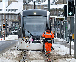 Pictured: Workers had to resort to using leaf blowers to keep the tram tracks clear in Edinburgh on Thursday morning.<br /> <br /> The severe winter weather continued to cause chaos throughout Scotland, with the most severe level of Amber warning being extended until 10am on Friday 02 March.<br /> <br /> © Dave Johnston / EEm