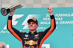 SEPANG, Oct. 1, 2017  Red Bull driver Max Verstappen of the Netherlands celebrates on the podium after the Formula One Malaysia Grand Prix at the Sepang Circuit in Malaysia, on Oct. 1, 2017. Max Verstappen claimed the title of the event. (Credit Image: © Chong Voon Chung/Xinhua via ZUMA Wire)