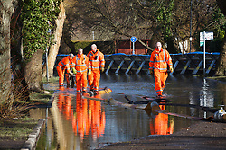 © Licensed to London News Pictures. 16/02/2014. Winchester, Hampshire, UK. Members of Hampshire Fire & Rescue managing the removal of flood water on Park Avenue, Winchester. Work is well underway by Hampshire Fire & Rescue and the Environment Agency to restore the flooded areas back to normality. Photo credit : Rob Arnold/LNP