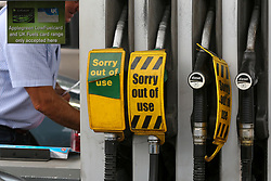 © Licensed to London News Pictures. 25/09/2021. London, UK. 'Sorry out of use' sign on a pump at a petrol station in Bounds Green, north London as drivers continue to panic buy petrol amid a fuel shortage fear arising from a shortage of HGV drivers. Photo credit: Dinendra Haria/LNP