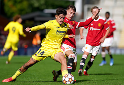Villarreal's Aitor Gelardo (left) and Manchester United's Martin Svidersky battle for the ball during the UEFA Youth League, Group F match at Leigh Sports Village, Manchester. Picture date: Wednesday September 29, 2021.