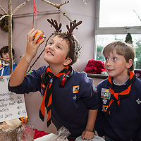 Aoibhín O'Connor and Gavin O'Brien smell the orange and cloves at the Ballyvaughan Christmas Fair