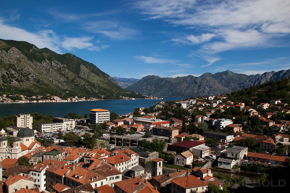 Elevated view of Kotor and the Gulf of Kotor with surrounding mountains.