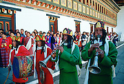 Musicians in festival procession in Tashichho Dzong in Thimpu, the capital of Bhutan