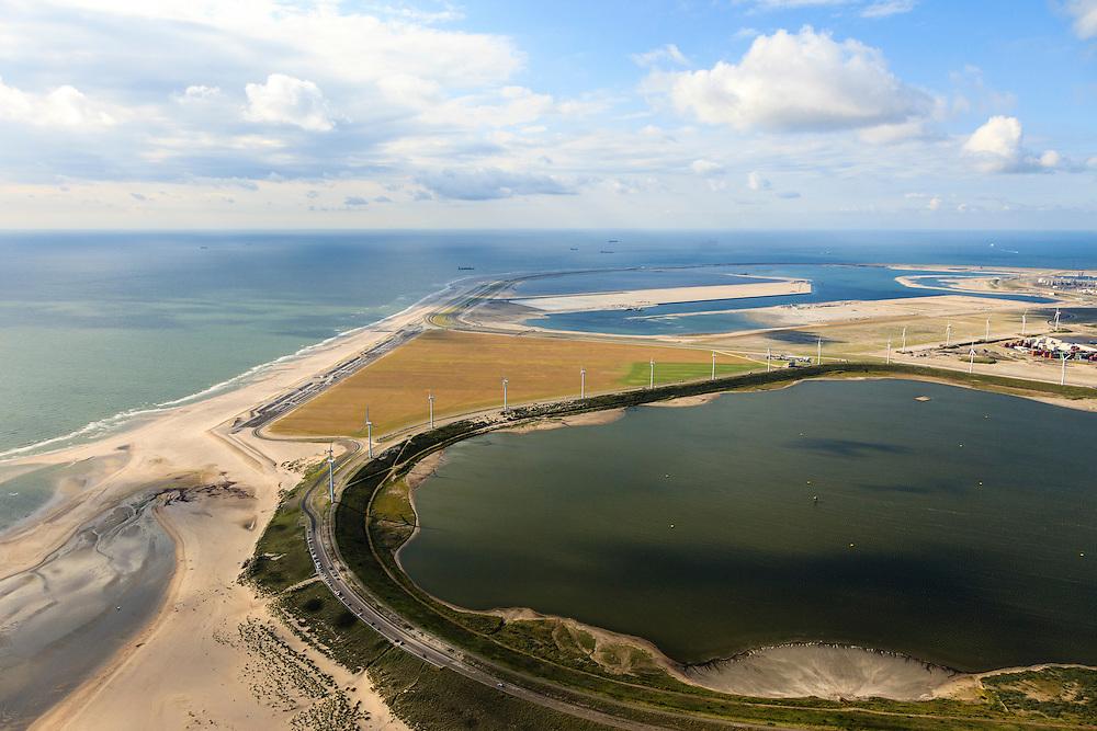 Nederland, Zuid-Holland, Rotterdam, 15-07-2012; zicht op De Slufter vanaf de Brielse Gatdam met de Tweede Maasvlakte in het verschiet. De Slufter is een grootschalige opslagplaats voor vervuild havenslib. De verontreinigde baggerspecie komt voort uit het onderhoudsbaggerwerk in de Rotterdamse haven waarbij de haven op diepte wordt gehouden. Langs de rand van de Slufter zijn windmolens gebouwd.The Slufter area in the South-West of the Netherlands, large-scale depot of contaminated harbor sludge from the Port of Rotterdam. Along the edge of the Slufter windmills are built.  The Second Maasvlakte in the background.luchtfoto (toeslag); aerial photo (additional fee required); .foto Siebe Swart / photo Siebe Swart