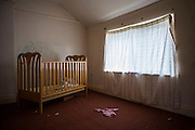 A babies cot in a bare room. Leyland, Lancashire.UK