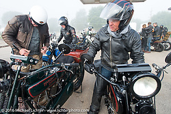 Dean Bordigioni and Scott Jacobs at the first gas stop after a brisk first leg through the fog during Stage 8 of the Motorcycle Cannonball Cross-Country Endurance Run, which on this day ran from Junction City, KS to Burlington, CO., USA. Saturday, September 13, 2014.  Photography ©2014 Michael Lichter.