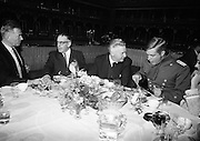 Actors James Mason (left) and George Peppard (right) at lunch with Taoiseach Sean Lemass during the filming of 'The Blue Max' in Ardmore Studios..16.09.1965