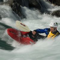 A kayaker plays in waves on the Kananaskis River in the Canadian Rockies near Calgary, Alberta.