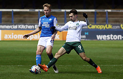 Frankie Kent of Peterborough United in action with Ryan Hardie of Plymouth Argyle - Mandatory by-line: Joe Dent/JMP - 24/11/2020 - FOOTBALL - Weston Homes Stadium - Peterborough, England - Peterborough United v Plymouth Argyle - Sky Bet League One