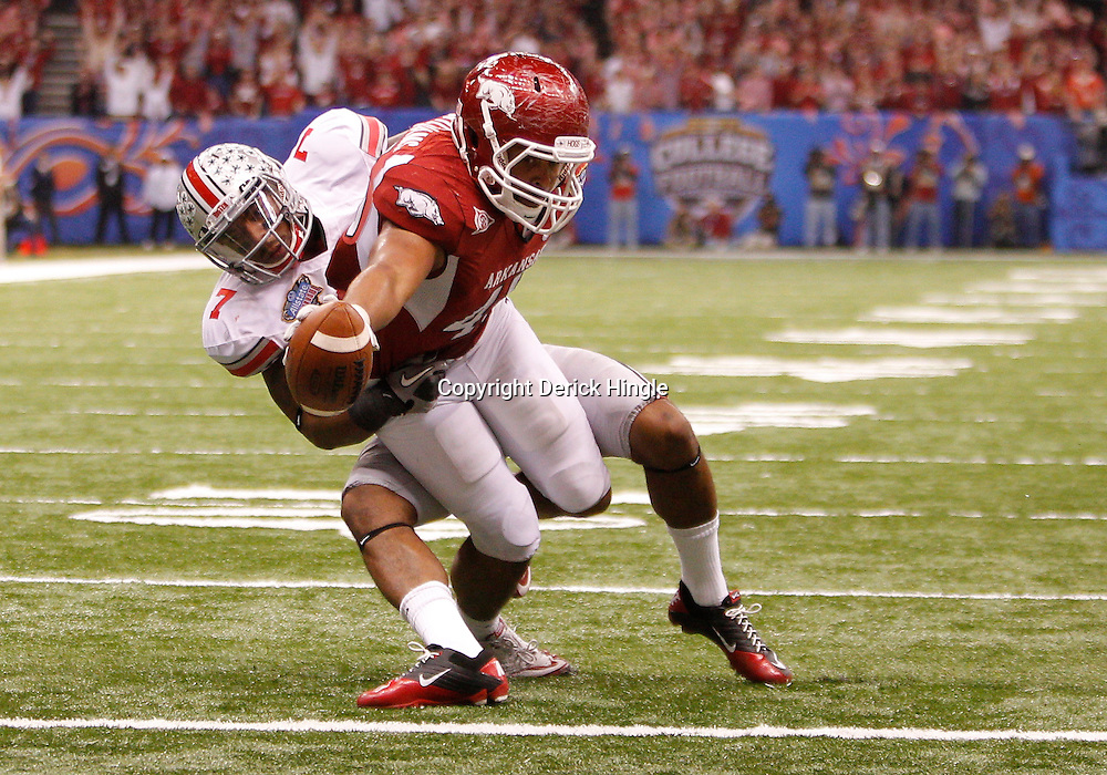 January 4, 2011; New Orleans, LA, USA;  Arkansas Razorbacks tight end D.J. Williams (45) stretches out with the ball on a two point conversion past Ohio State Buckeyes defensive back Jermale Hines (7) during the third quarter of the 2011 Sugar Bowl at the Louisiana Superdome.  Mandatory Credit: Derick E. Hingle