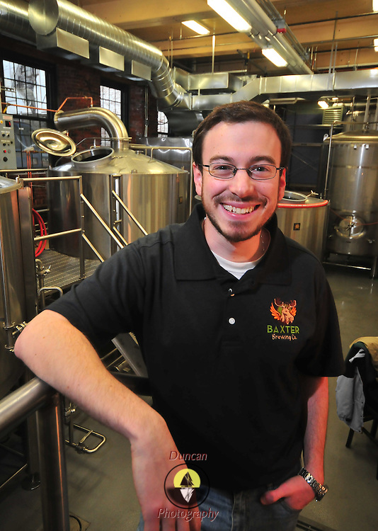 12/20/10 --LEWISTON, Maine.  Luke Livingston, Clark University graduate and founder of Baxter Brewing in Lewiston, Maine, is producing his first beers this month -- building a business in the Bates Mill facility, abandoned since the mid 1990s.  Photo by Roger S. Duncan.