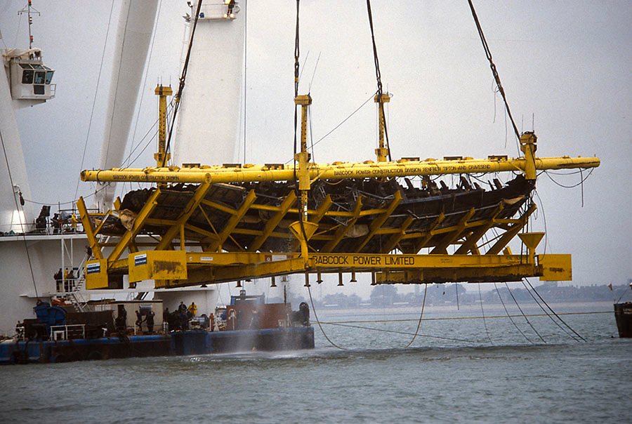 the Tudor warship The Mary Rose seen being raised from the Solent seabed off Portsmouth, UK in 1982. Photograph by Jayne Fincher