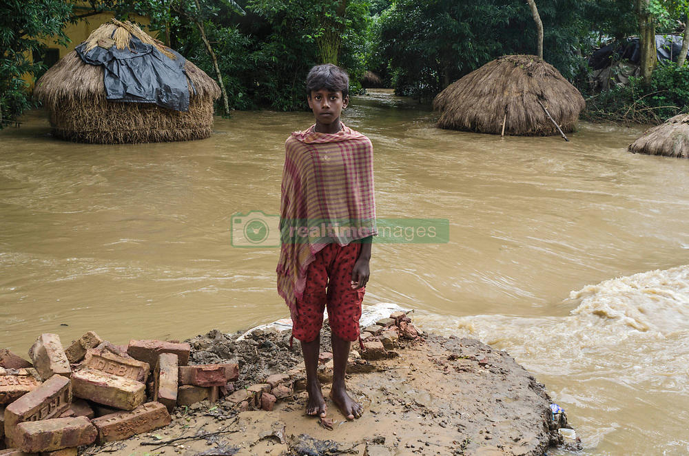 July 27, 2017 - Kolkata, west bengal, india - Udaynarayanpur, a village of Howrah district .of West Bengal, India, where flood take place. On thursday 27th July 2017 Damodar valley .corporation (DVC) release more water from its dams and sounded red alert. The disaster takes place when barrage .at Udaynarayanpur broken due to heavy flow of water that comes from dams. Till date 90 .villages submerged as per local officials report. (Credit Image: © Debsuddha Banerjee via ZUMA Wire)