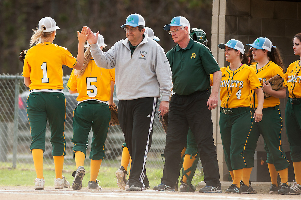 BFA head coach Richard Berthiaume high fives Samantha Dussault during the girls softball game between BFA-St. Albans and Mount Mansfield at MMU High School on Thursday afternoon May 8, 2014 in Jericho, Vermont. (BRIAN JENKINS, for the Free Press)