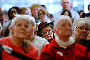 Supporters listen as Democratic U.S. presidential candidate Hillary Clinton speaks during a Get Out the Caucus event with Senator Cory Booker at the Vernon Middle School in Marion, Iowa, January 24, 2016. REUTERS/Scott Morgan