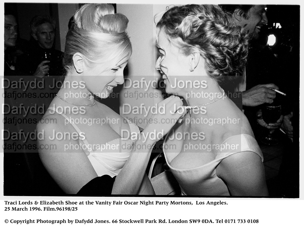 Traci Lords & Elizabeth Shoe at the Vanity Fair Oscar Night Party Mortons,  Los Angeles. 25 March 1996. Film.96198/25<br />