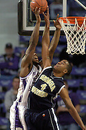 Georgia Southern forward Sean Oliver (R) blocks Kansas State's David Hoskins (L) drive to the basket, during the first half of the Wildcats 83-58 win over the Eagles at Bramlage Coliseum in Manhattan, Kansas, November 19, 2005.