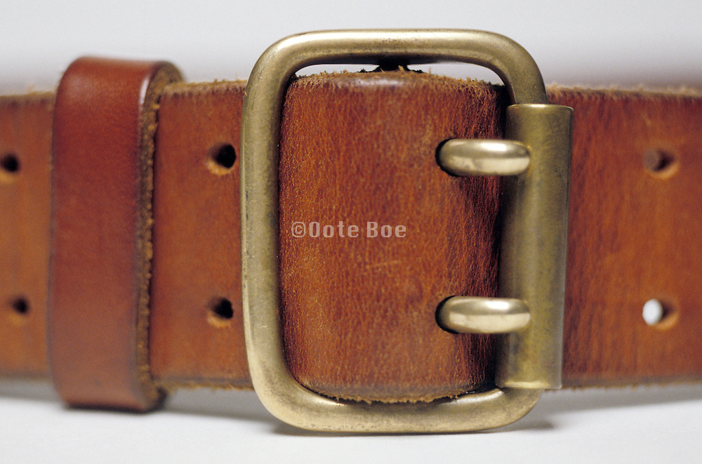close up of leather belt buckle