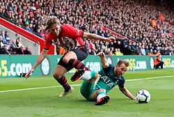 Southampton's Jannik Vestergaard (left) and Tottenham Hotspur's Harry Kane battle for the ball during the Premier League match at St Mary's Stadium, Southampton.