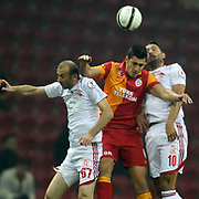 Galatasaray's Ceyhun Gulselam (C) and Balikesirspor's Salih Sefercik (L), Ali Ozturk (R) during their Turkey Cup matchday 4 soccer match Galatasaray between Balikesirspor at the AliSamiYen Spor Kompleksi TT Arena in Istanbul Turkey on Tuesday 27 November 2012. Photo by TURKPIX